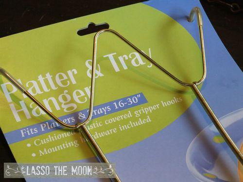 Use a platter hanger to hang vintage mirror