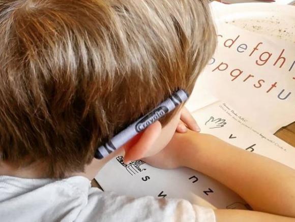 Eli Kindergarten crayon behind ear